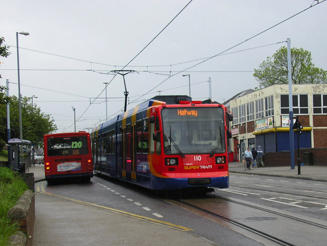 A tram and bus in City Road near Manor Top, Sheffield