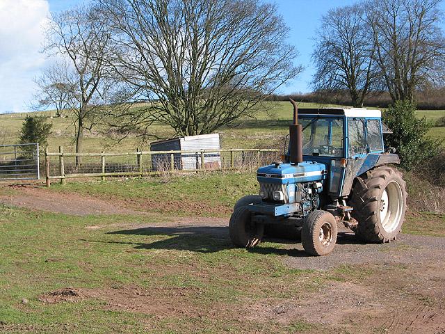Tractor by a hillside in Welsh Newton