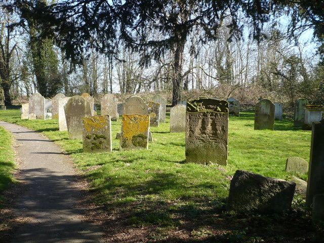 Path through the churchyard leading to the Stour Valley Walk