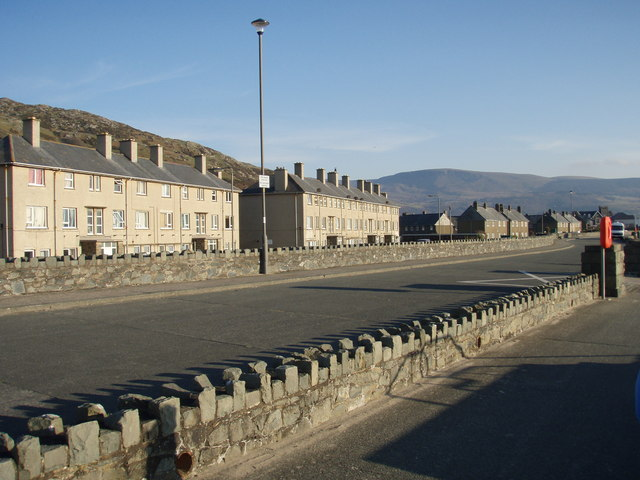 A promenade council estate with Braich Ddu in the distance