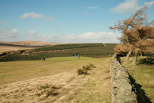 Golfers on the 13th green at Galashiels Golf Course