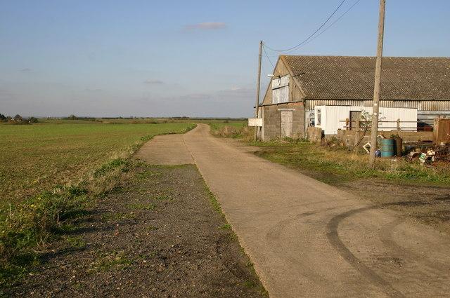 Footpath by farm building