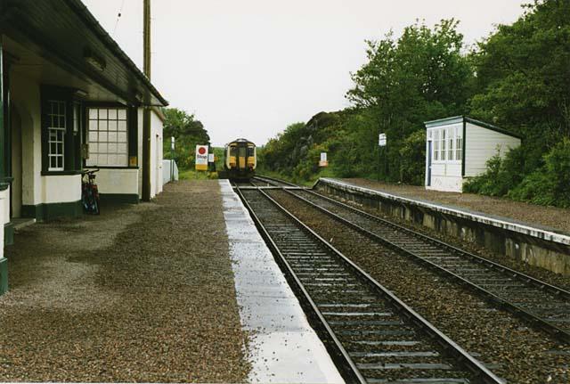 Arisaig station, with a Mallaig bound train leaving