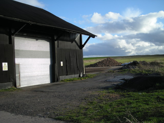 Big black shed with big steel roll-up doors