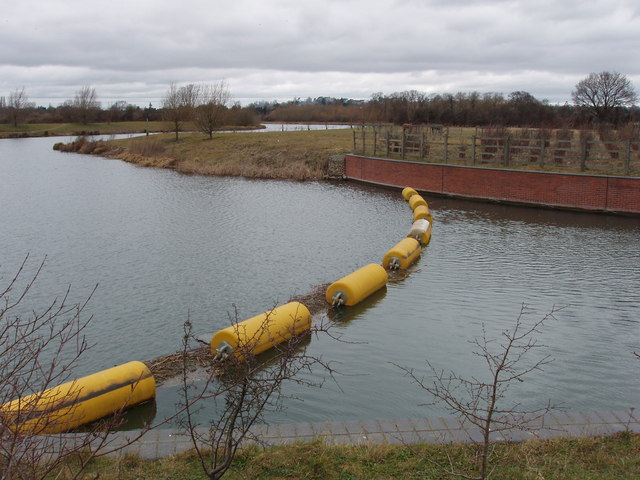 Floats and chain catch debris before weir