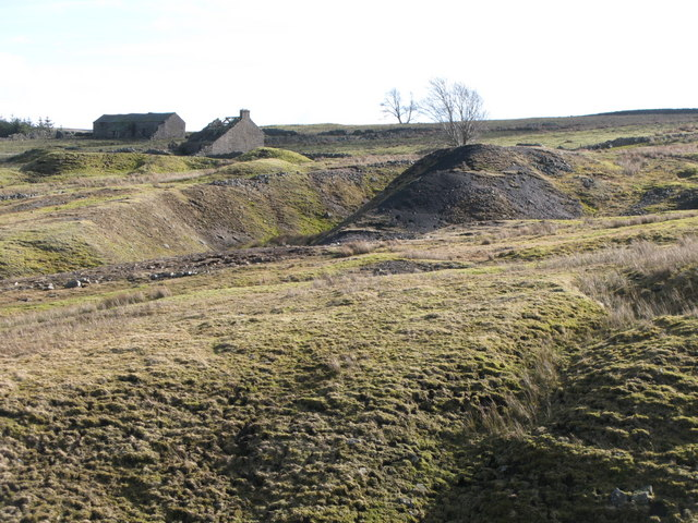 Hush, spoil heaps and ruins in former mining area