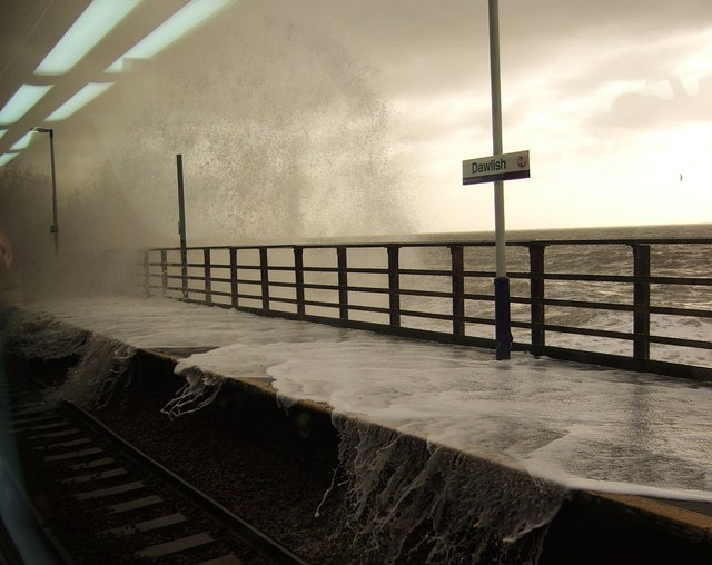 Sea breaking onto platform at Dawlish station