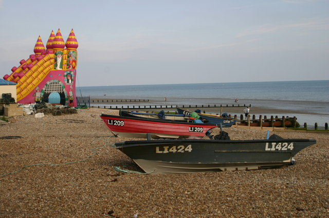 Fishing boats and bouncy castle