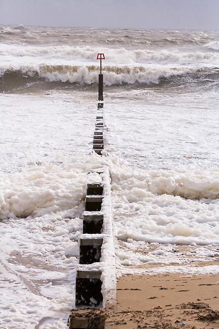 Stormy sea breaking on groyne west of Hengistbury Head