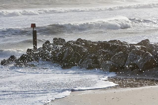 Wind blown spume over breakwater west of Hengistbury Head