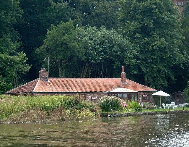 Riverside bungalows, Underhill Reach, River Yare