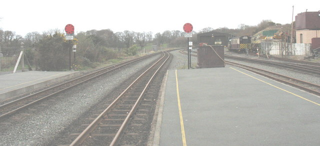 Twin red signal disks at the north end of Dinas station