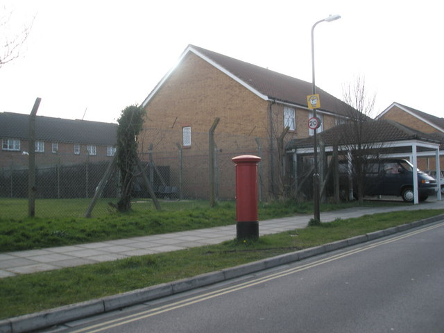 Postbox by small field in Matapan Road