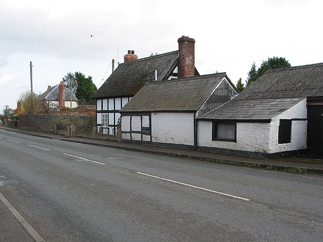 Half-timbered cottage and outbuildings