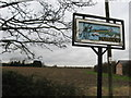 TL4986 : Pymoor village sign by Colin Bell
