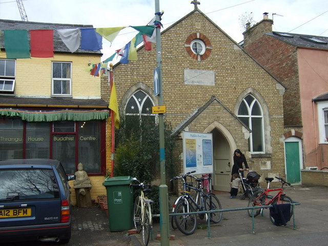 Prayer flags and bicycles in Magdalen Road