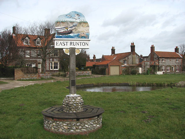 Village sign and pond at Low Common