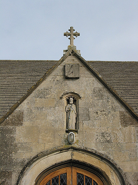 Statue of St. Giles in a niche above the porch
