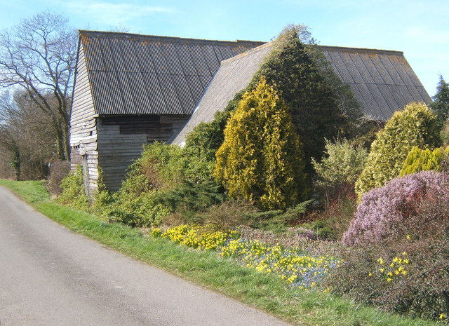 Barn with colourful early spring garden, Milden