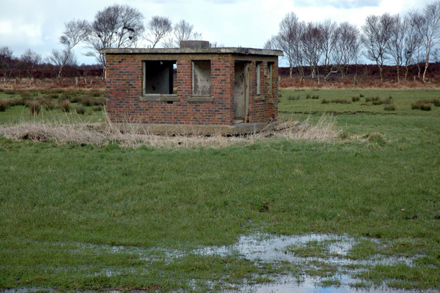 Disused brick building on Bowness Common