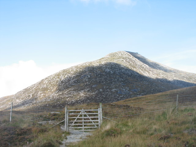 Halfway up the Goatfell: crossing the red deer fence