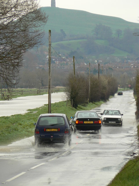Cars negotiating March floods