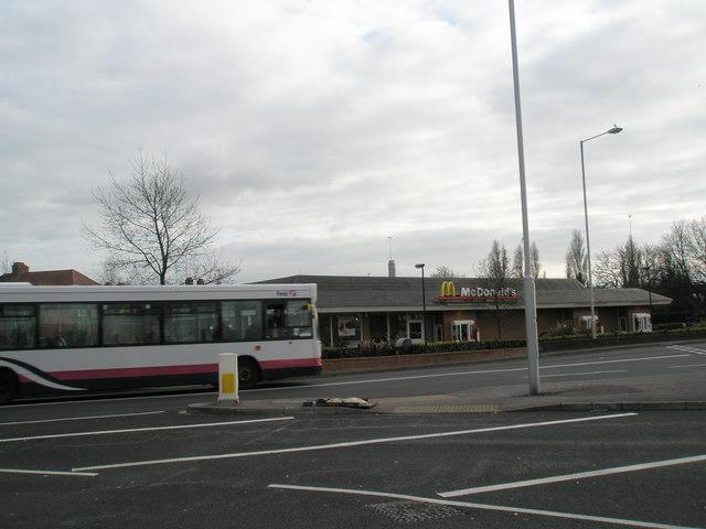 Bus passes the Portsbridge McDonald's at Cosham