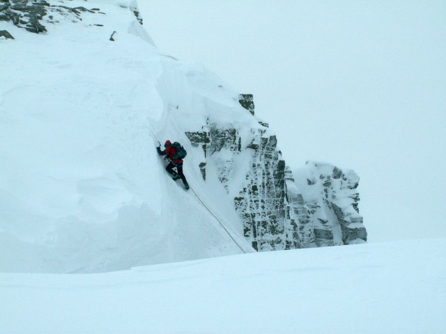 A climber nearing the top of  Vent Rib
