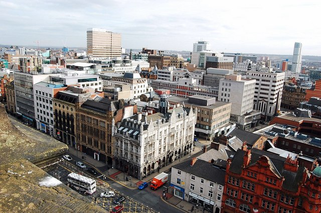 Leeds city panorama over looking the Headrow from the town hall clock tower.