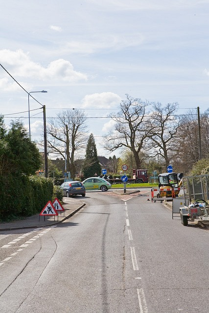 Lower Common Road emerges onto roundabout at Canada Corner, West Wellow