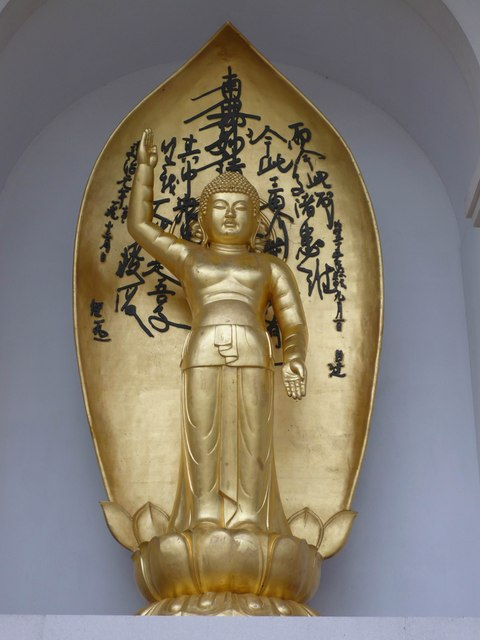 One of the buddhas on the pagoda by the Thames