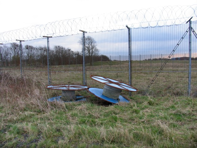 Debris by the fence