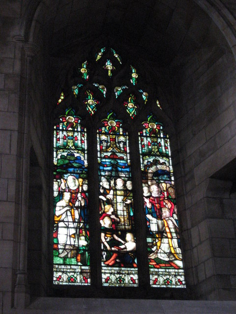 Stained glass window at the west end of the aisle