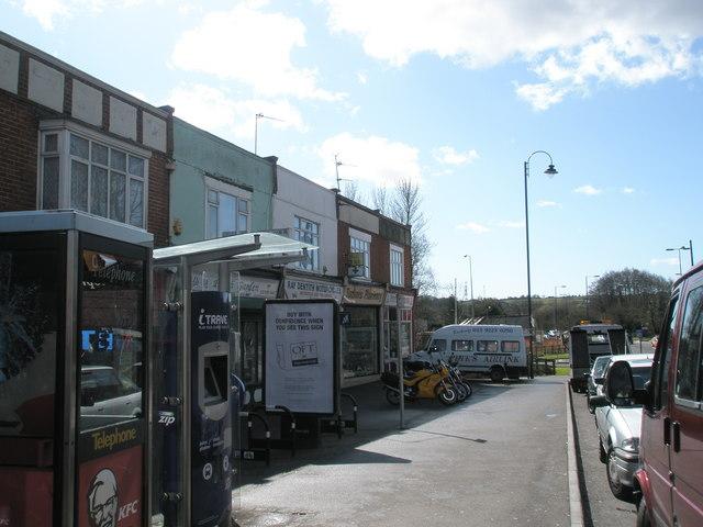 Row of shops opposite St John's Purbrook