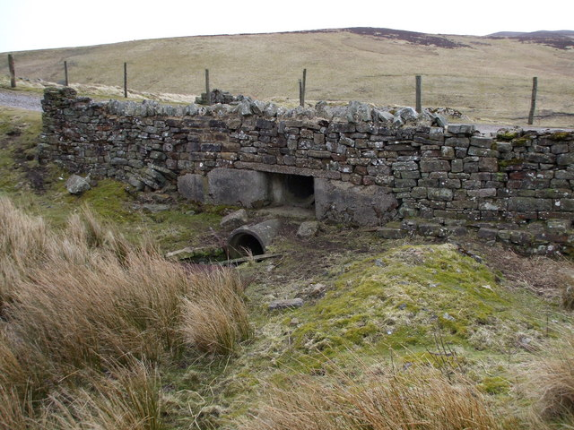 Concrete Culverts Hidden By a Stone Wall