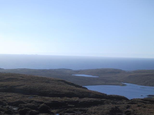 Loch Mheacleit with Flannan Isles behind
