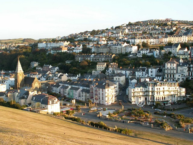 "Ilfracombe East with St James and St Philip's church to the left and ""The Comp"" on top of the hill"