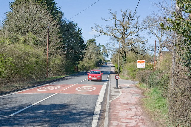 Salisbury Road (A36) passes the Post Office at West Wellow