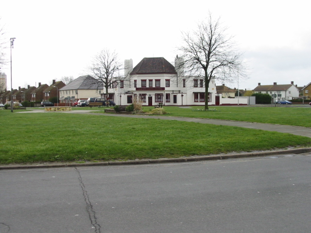 Grassed roundabout and the Flowing Bowl pub, Newington