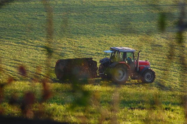 Farmer muck spreading