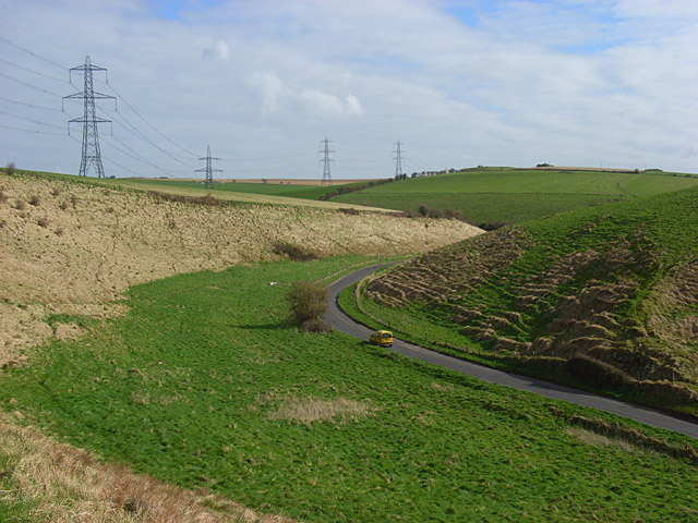 Downland, pylons and road, Bincombe