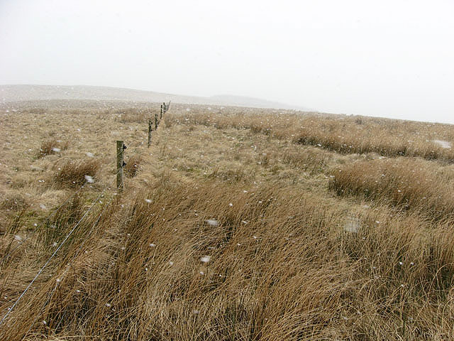 Walking towards Raes Knowes in a snow shower