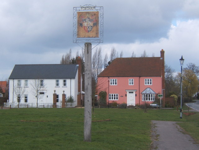 Village sign and houses by the green, Fordham