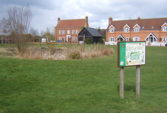 Village green with informative sign, Fordham