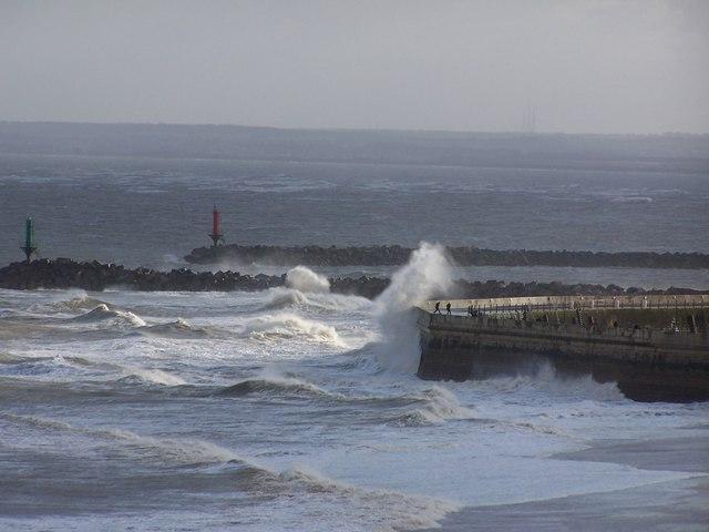Waves breaking over Ramsgate Harbour