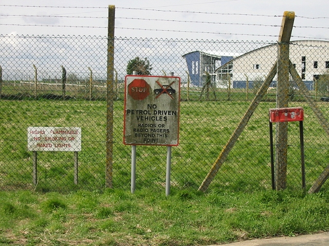 Signs on fenced off storage area