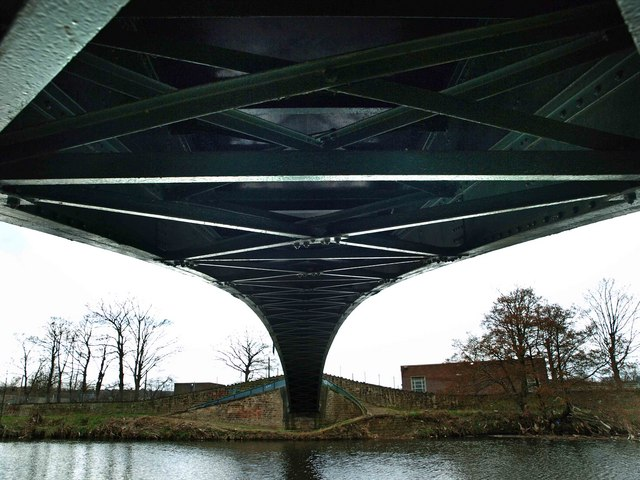 Underneath the arch bridge over the River Calder