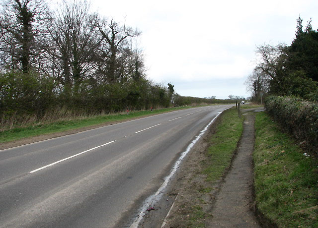The A1151 and footpath past St Lawrence's church
