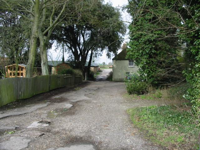Entrance to Alland Grange off a lane of the same name