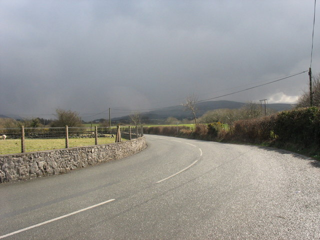 Sharp bend on the Bethel to Llanrug road just before a hail shower